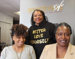 "Pictured l-r: Better Love Yourself volunteer staff members; Jamie Douglas, Katrina Douglas and Alexis ""Moxy"" Wallace."